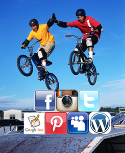 Image of boys on bikes jumping over stack of social media logos.